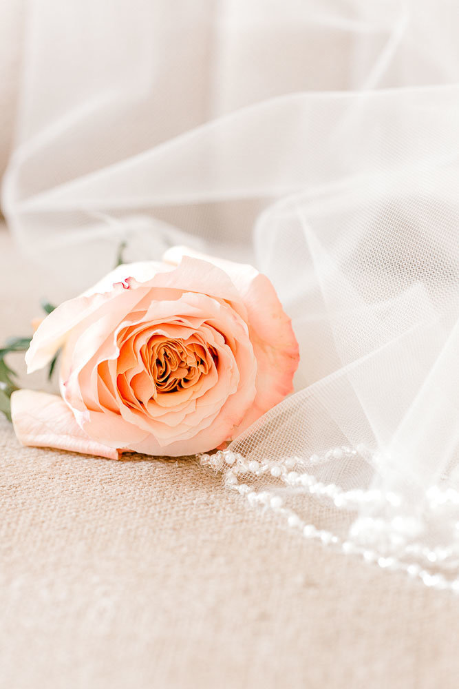 peach Rose and a veil wedding day detail photo.
