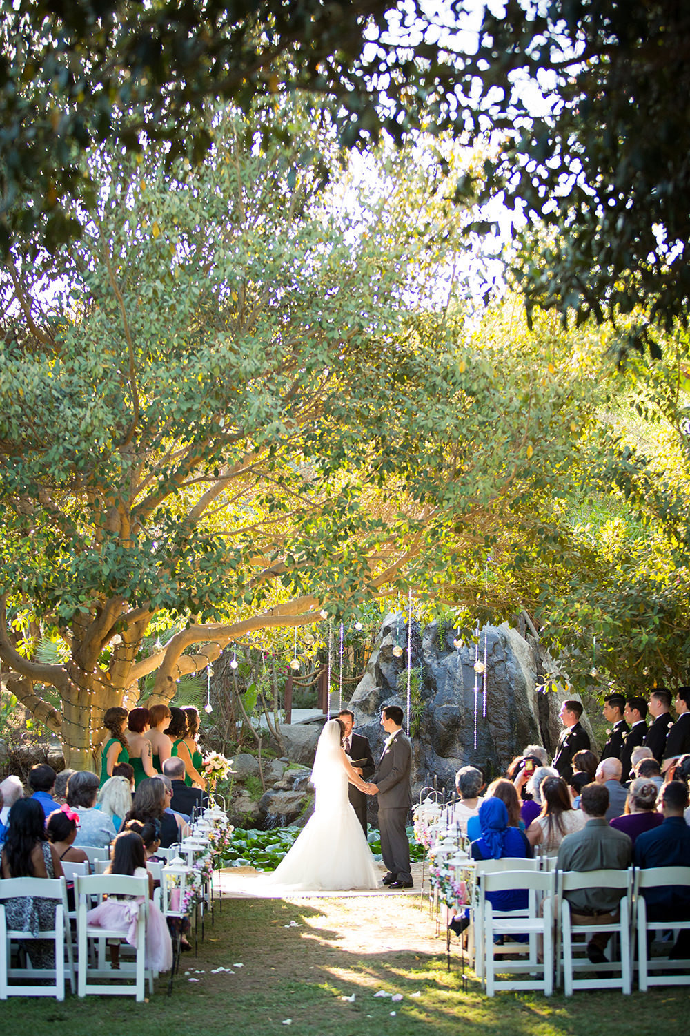 ceremony location with waterfall and trees