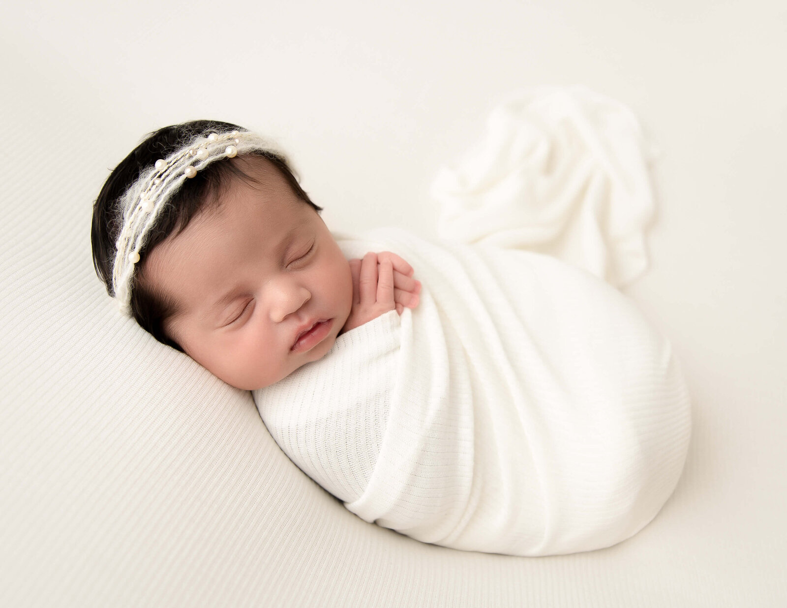 Sleeping newborn posed at our Rochester, NY studio.
