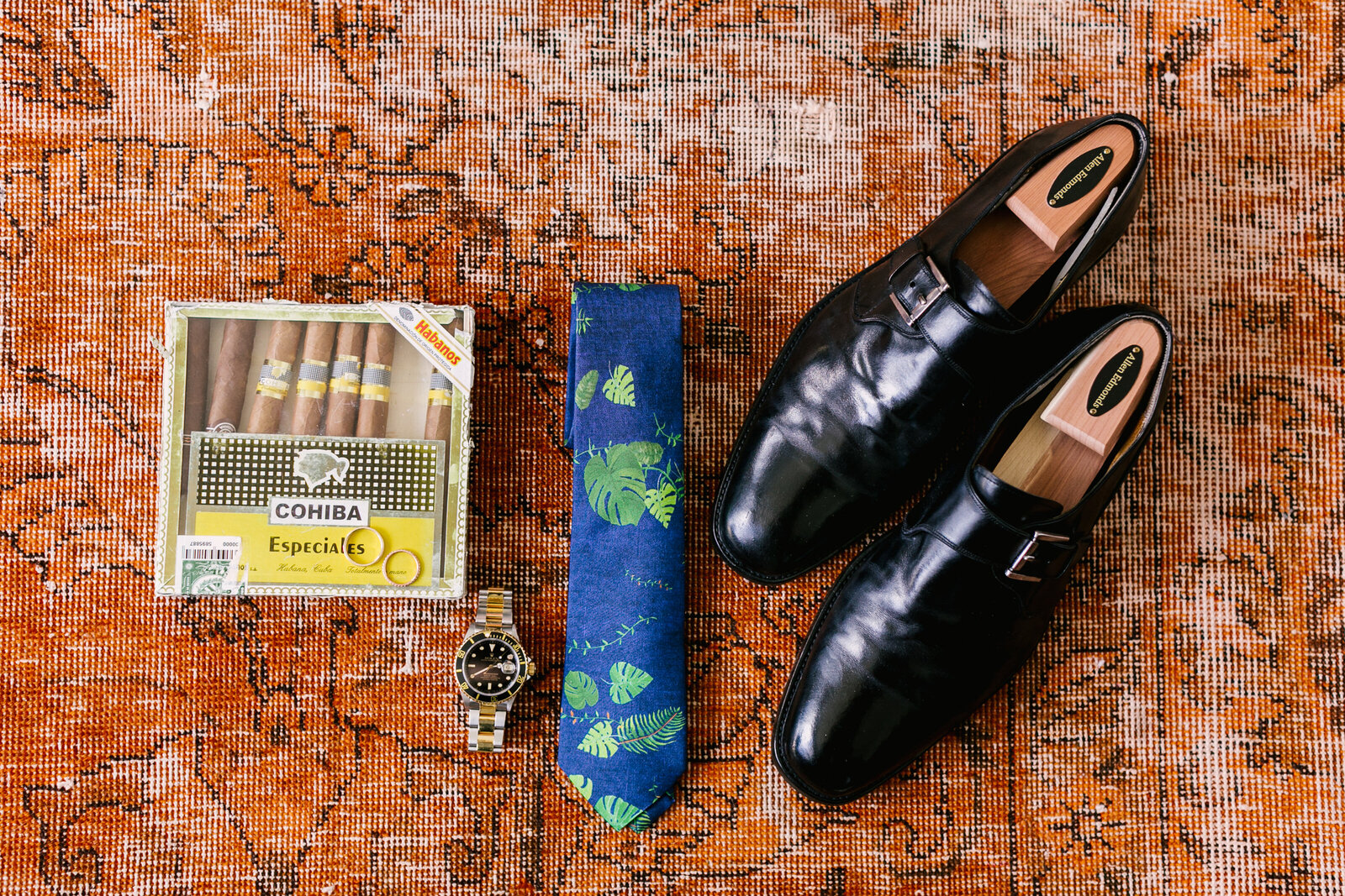 grooms details with tie and cigars