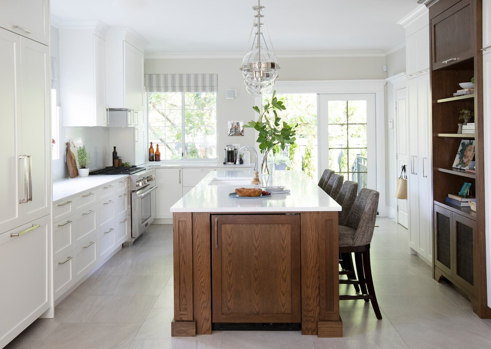 Granville Street l Kitchen l White Shaker Cabinet with Wood Island and Globe_Chrome Pendants