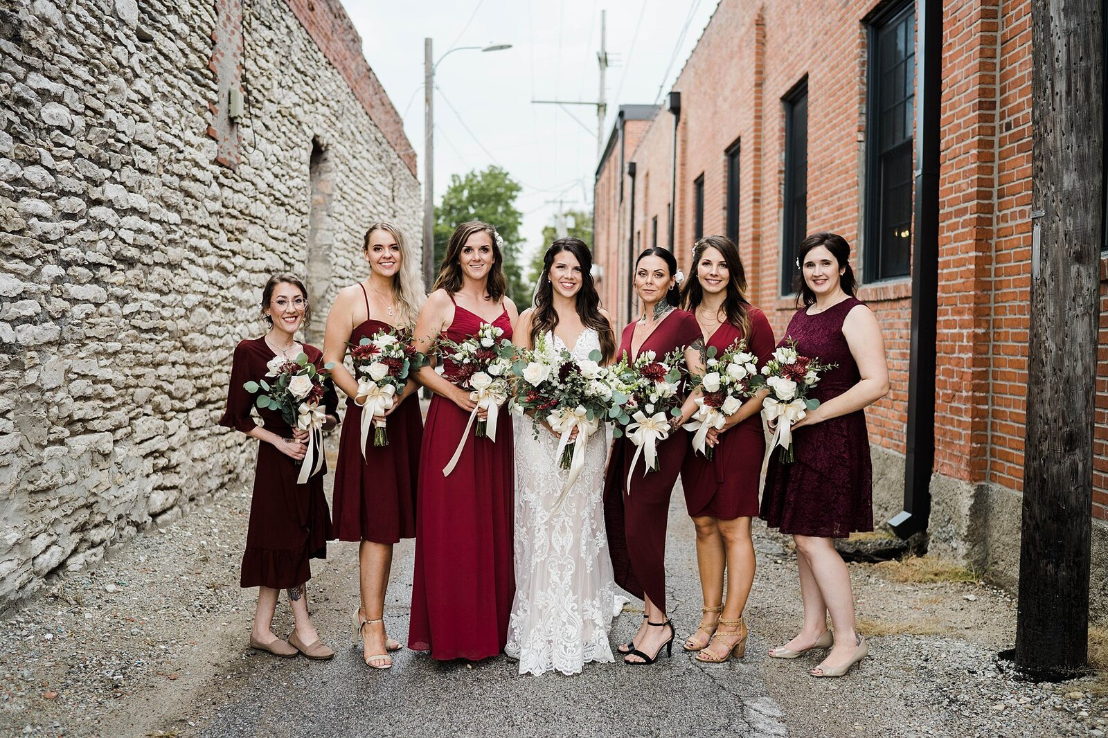 Bride and her bridesmaids in the alley at the Beck
