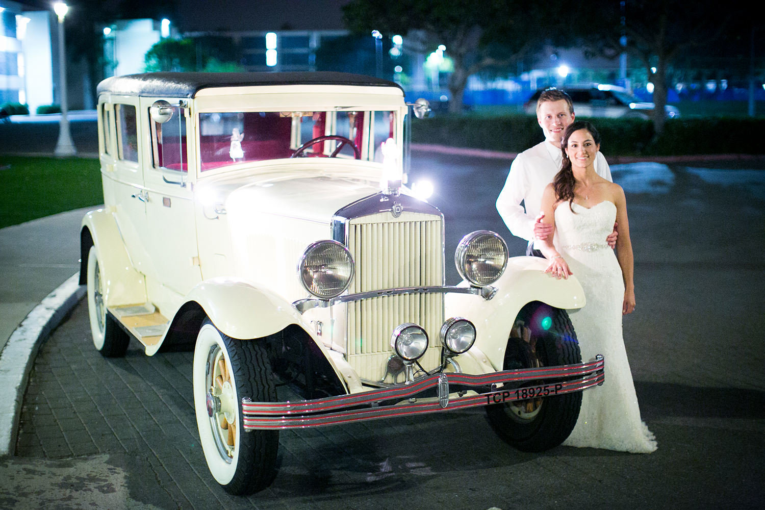 bride and groom with classic car night shot at admiral kidd club