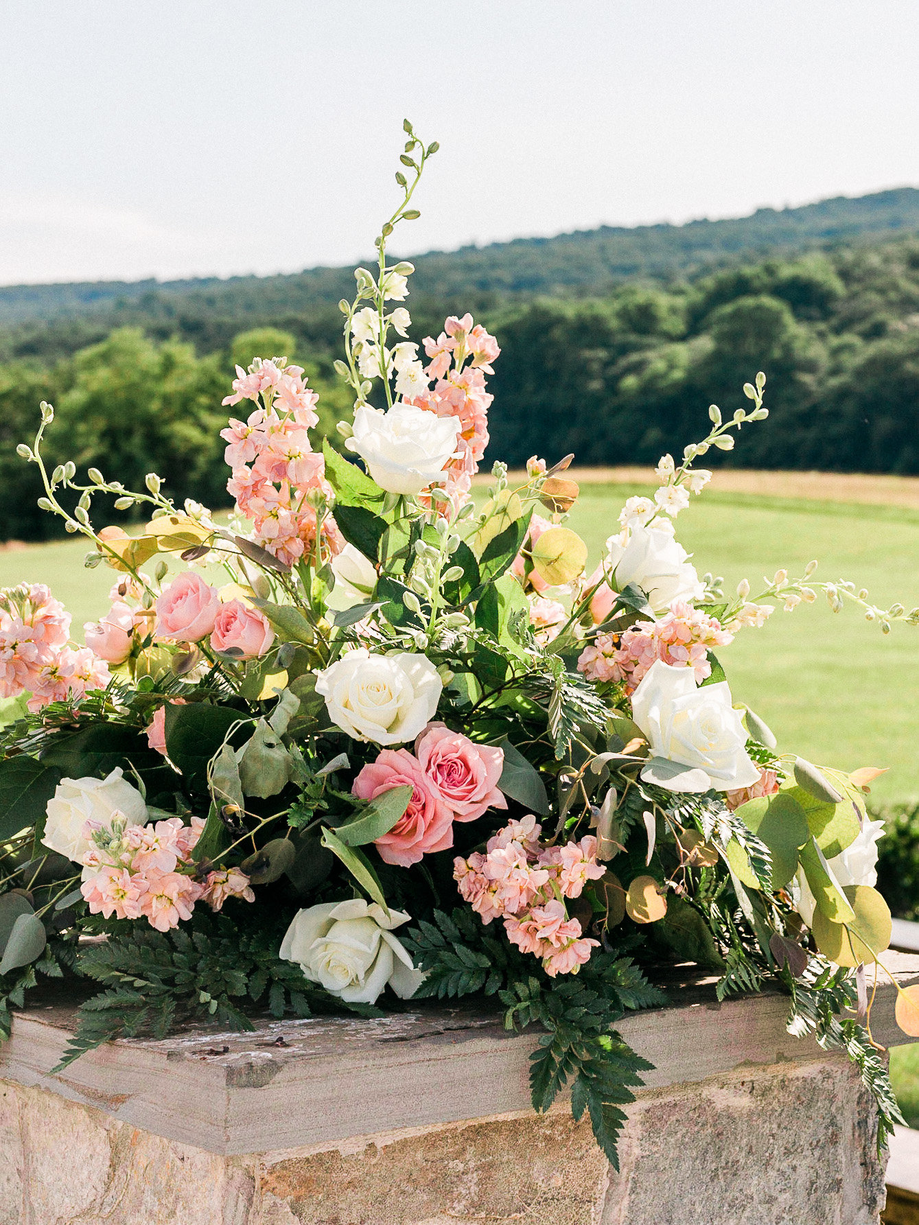 Pink and white floral ceremony decor