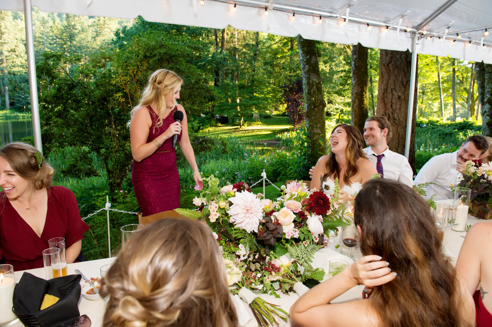maid of honor gives funny toast and everyone laughs