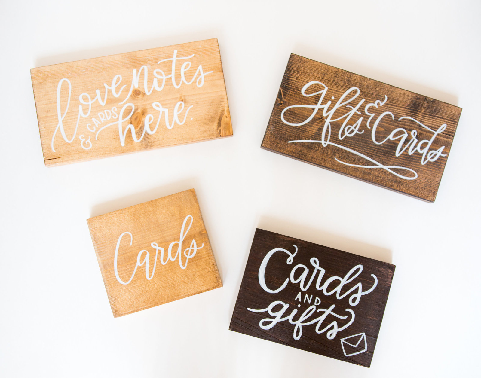 various wood signs with white calligraphy for gifts and cards to rent for weddings and events with Hue and FA rentals