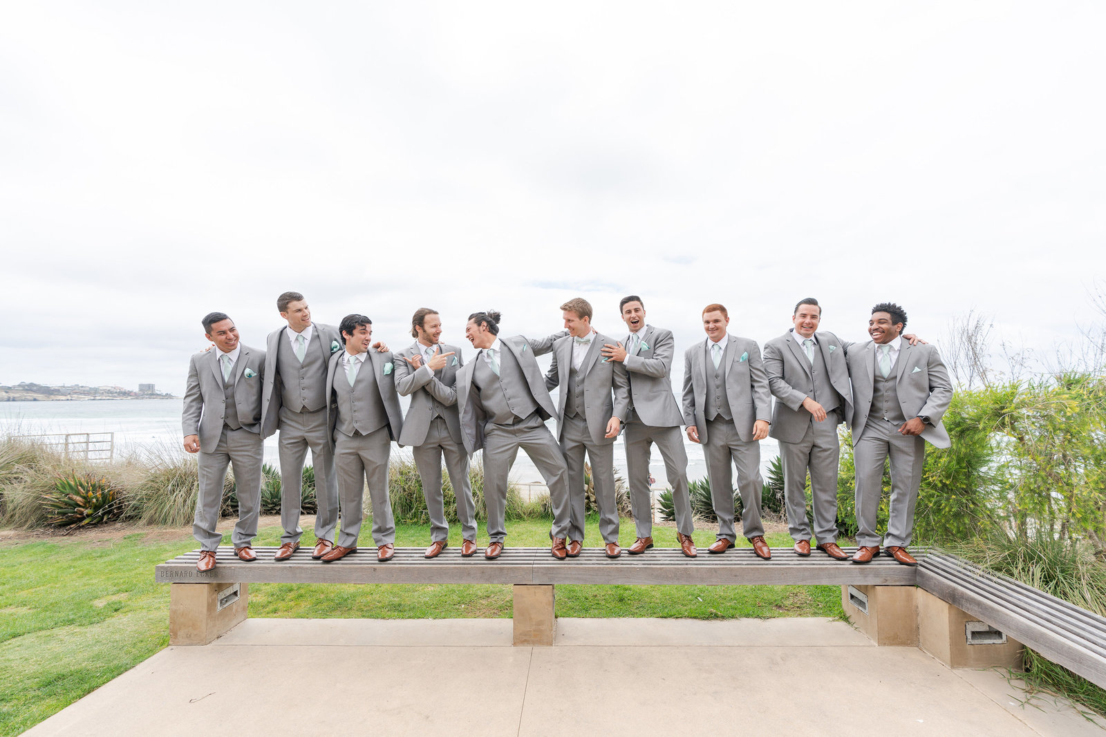 Groomsmen all together on wedding day at Scripps Seaside Forum Wedding Venue