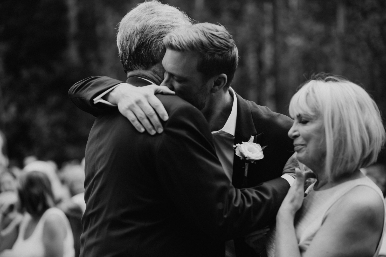 groom hugging his dad on his wedding day