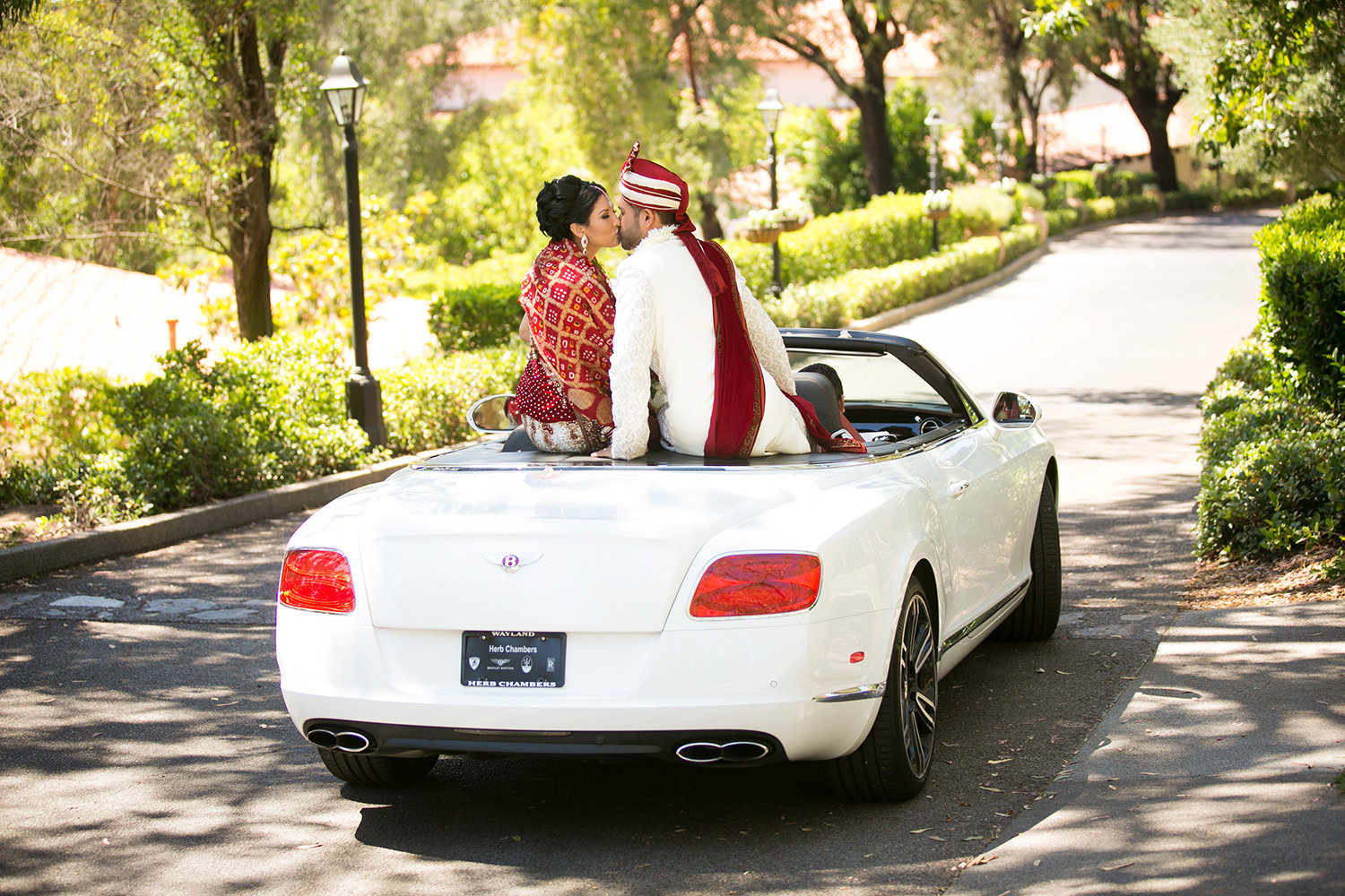 Indian bride and groom make their grand exit in a Bentley