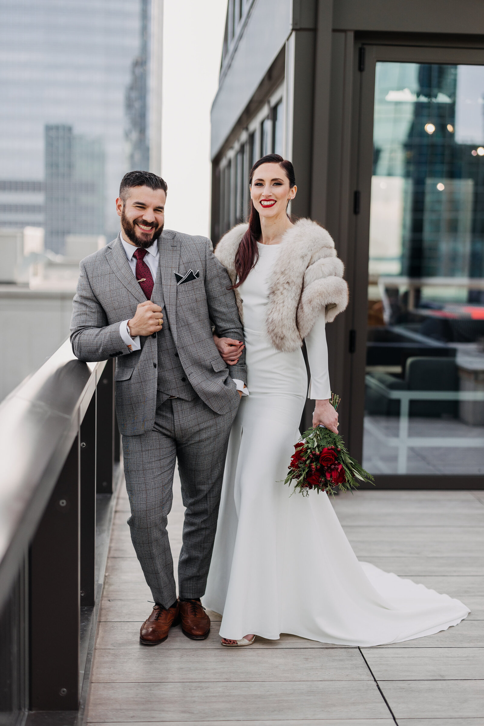 bride and groom city skyline rooftop