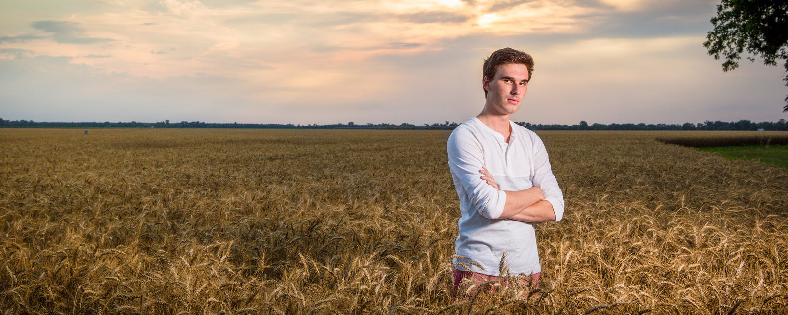 Garrett Roxbury senior portrait session in a wheat field at Atmore, Alabama.