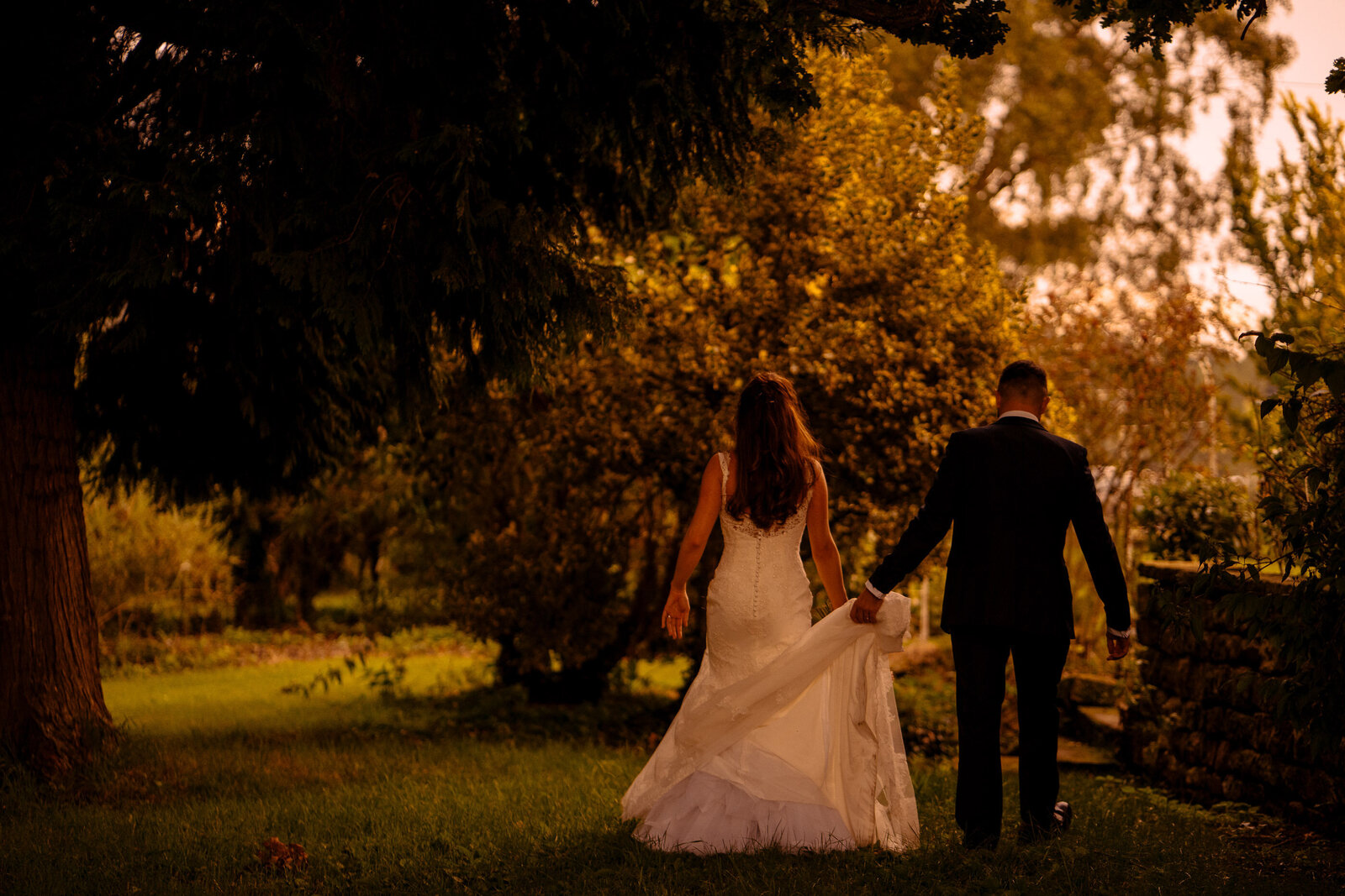 Bride and groom in the orchard at Wharfedale Grange Wedding venue