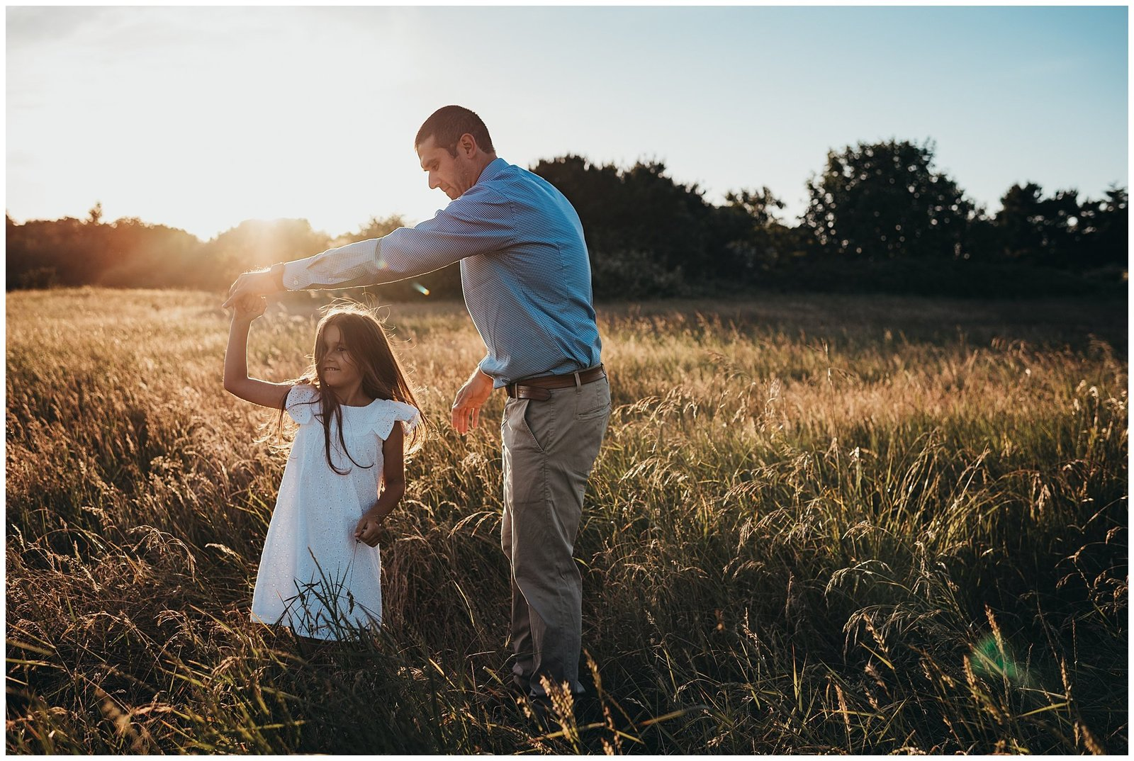 Dad dancing with daughter in field at sunset Emily Ann Photography Seattle Photographer