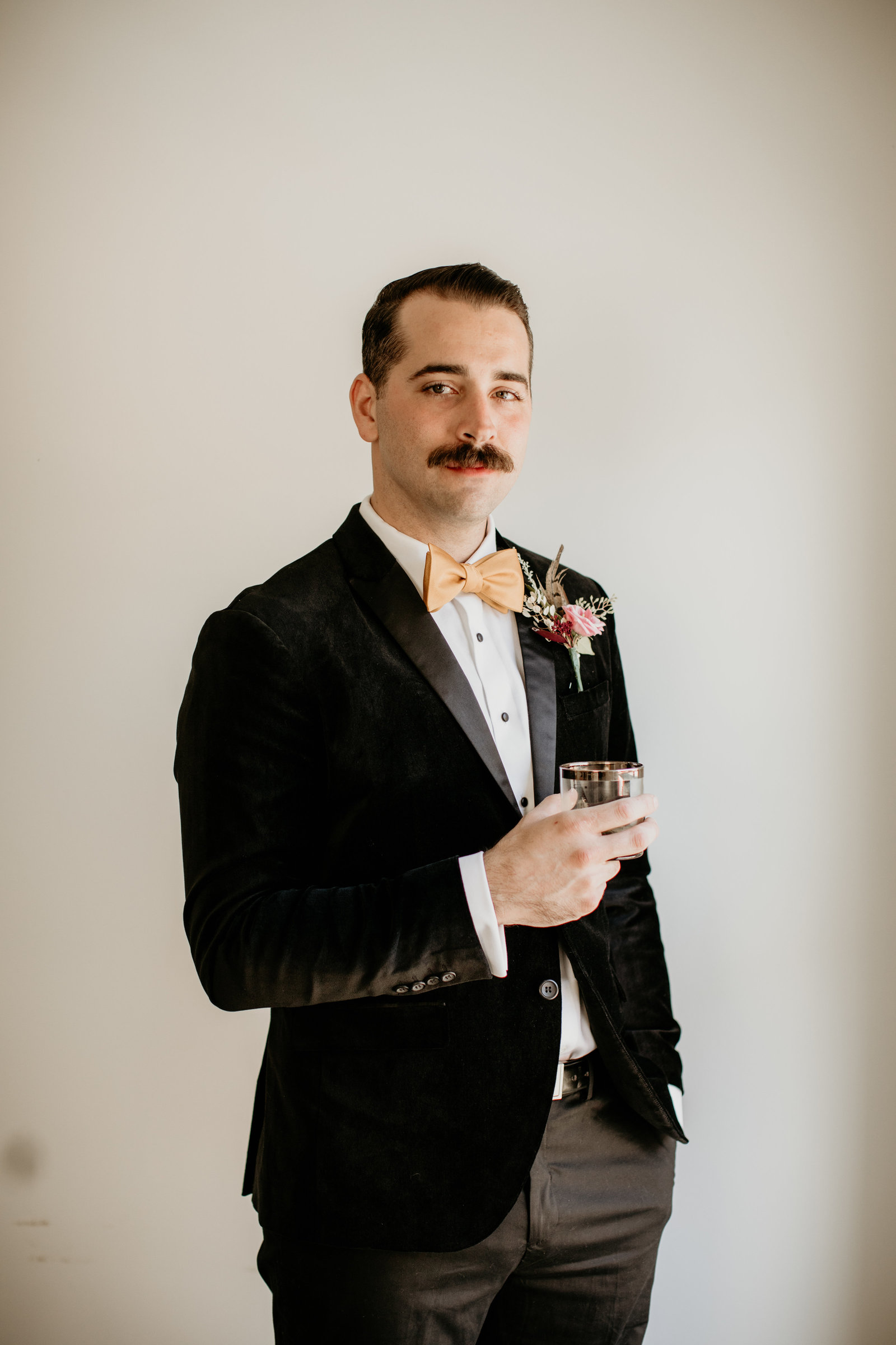 Groom poses for a photo.