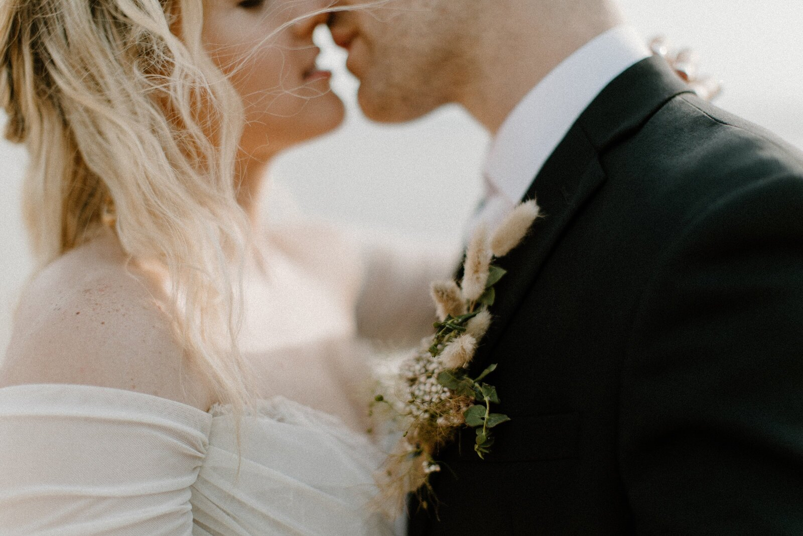 detail of bride and groom kissing close up
