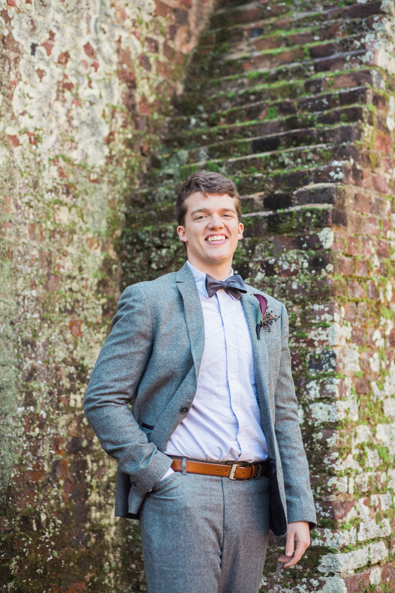 Groom stands by brick building, Boone Hall Plantation, Charleston, South Carolina