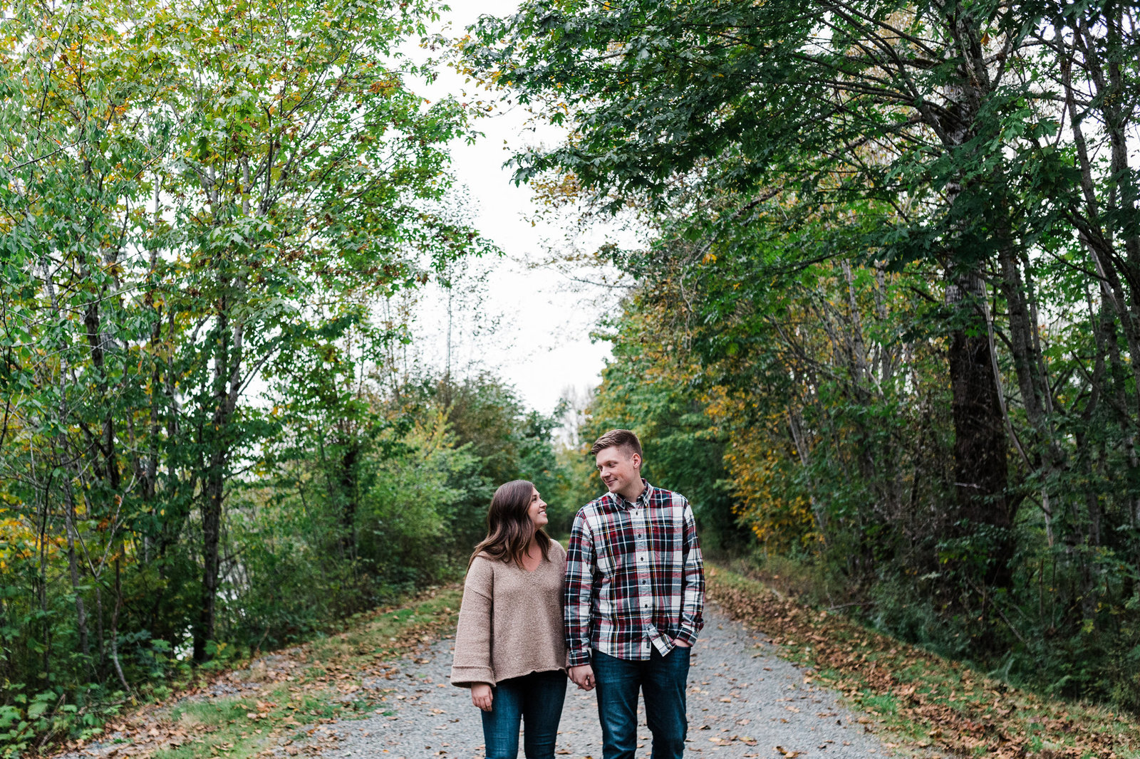 a couple strolls along a trail together in North Bend during the fall season with Seattle elopement photographer Amy Galbraith