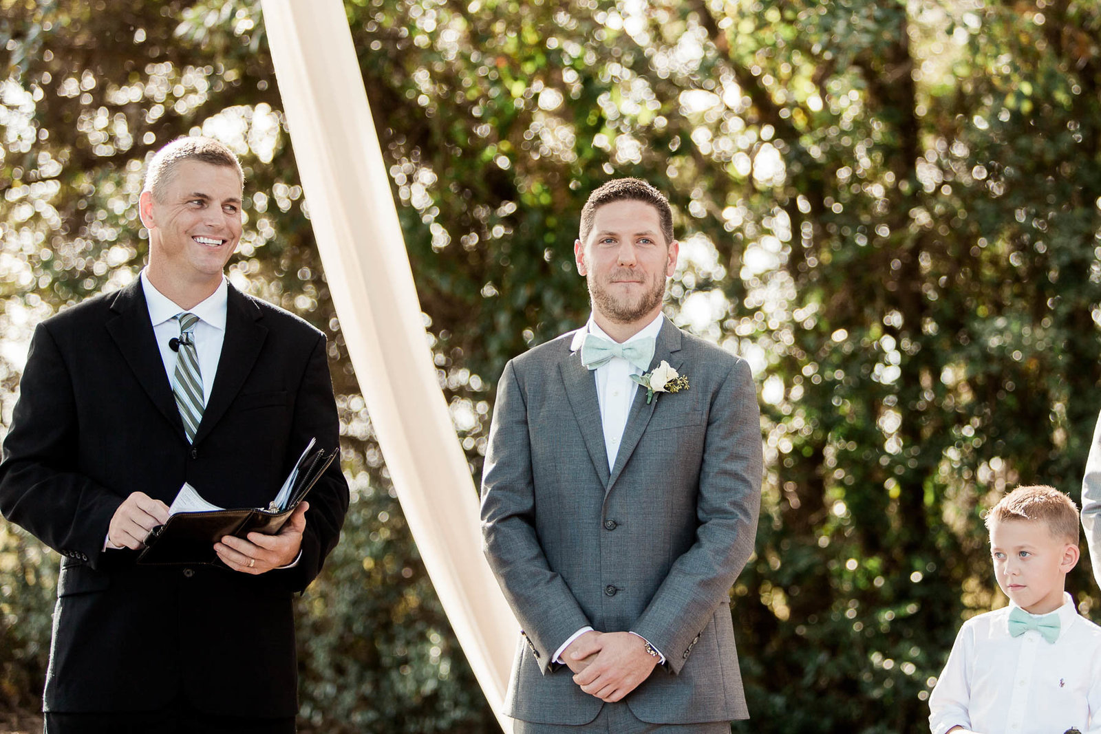 Groom sees bride for the first time, Alhambra Hall, Mt Pleasant, South Carolina. Kate Timbers Photography.