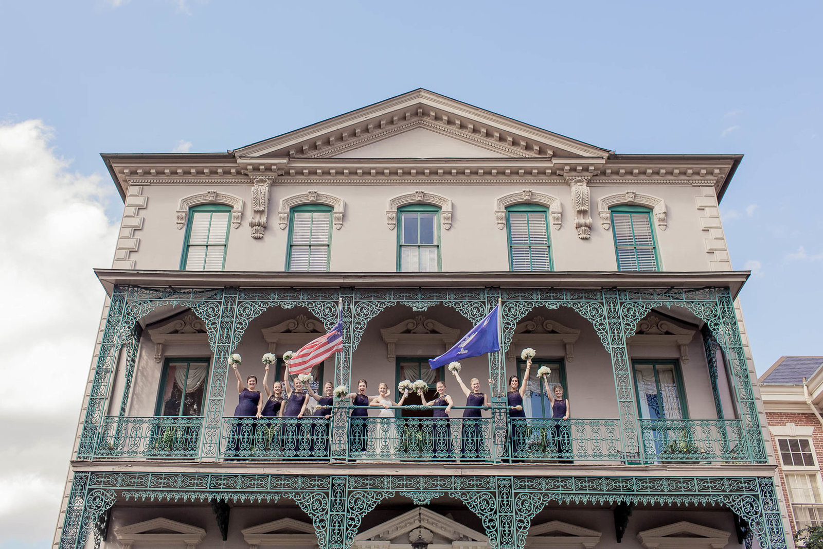 Bride and bridesmaids pose on balcony, John Rutledge House Inn, Charleston, South Carolina