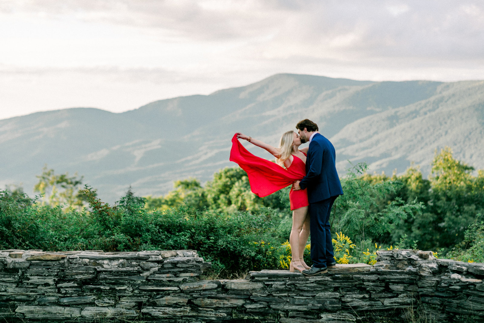 Newly engaged couple with a beautiful view captured by Staci Addison Photography