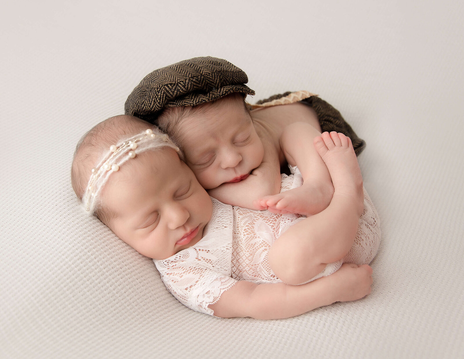 Adorable twins posed at our studio in Rochester, NY.