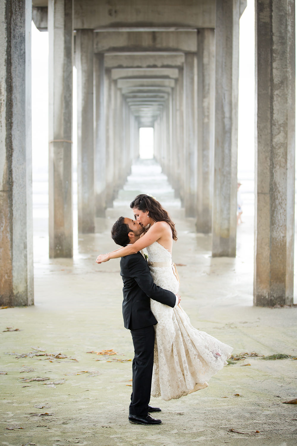 scripps pier with bride and groom