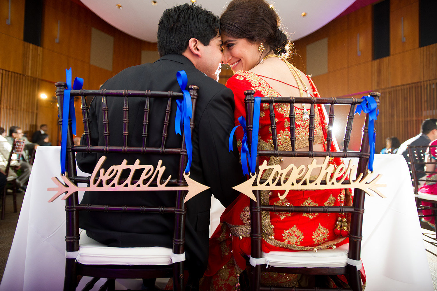 bride and groom at sweet heart table