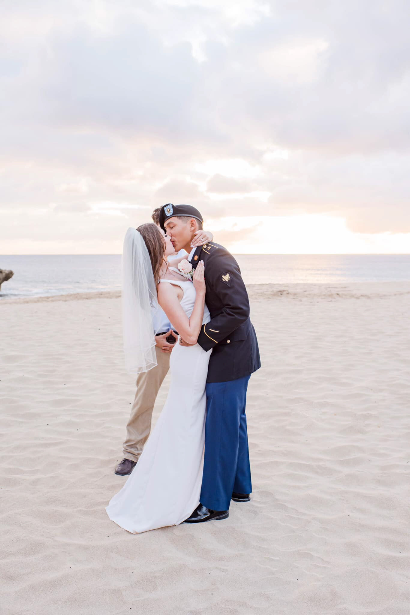 Monterey Wedding Photographer, couple kissing on the beach