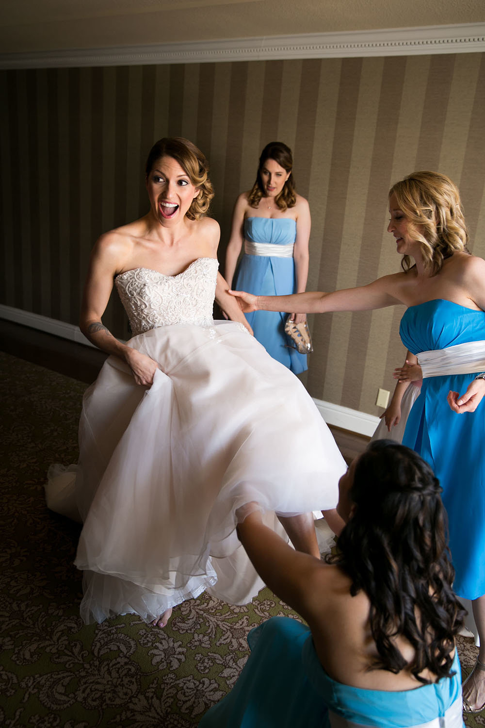 Bride and bridesmaids getting ready before the wedding ceremony