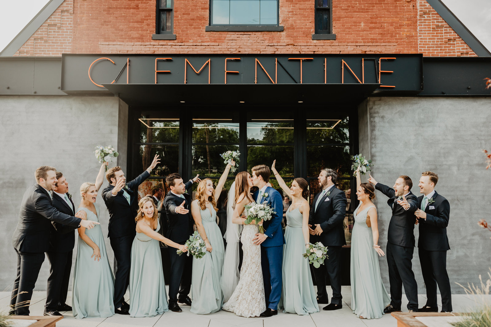 Bridal Party cheering for couple kissing at Clementine Hall