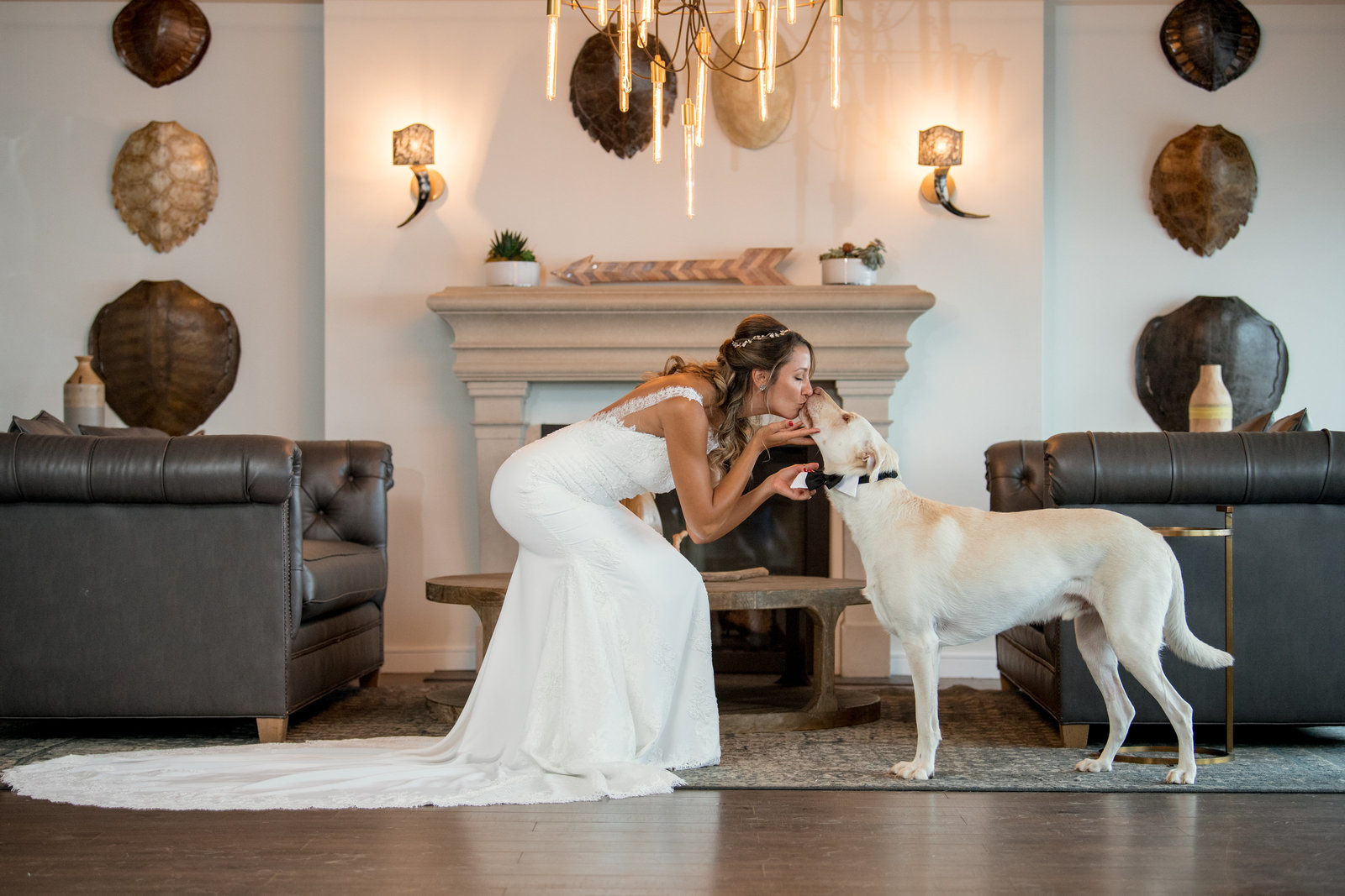 photo of bride kissing her dog inside the Gurneys Montauk Resort wedding