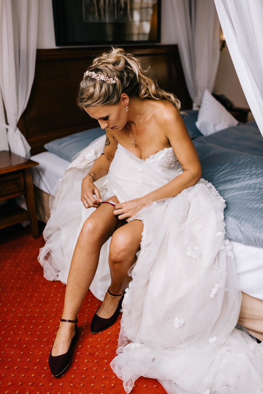 Bride Stephanie wearing Burgundy Garter