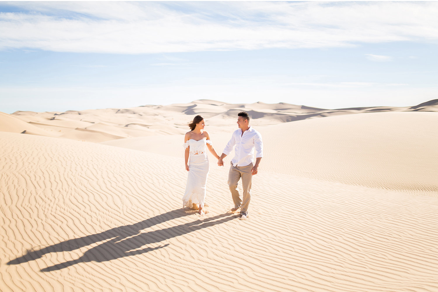 Bride and Groom Walking in the Desert Sand Dune Wedding Photo in Glamis