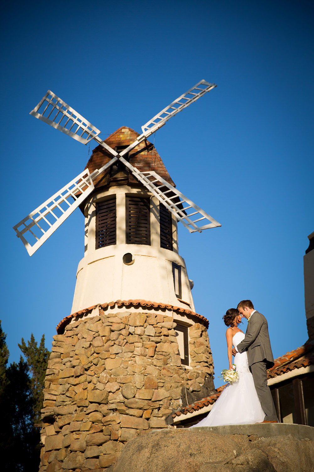 windmill with bride and groom