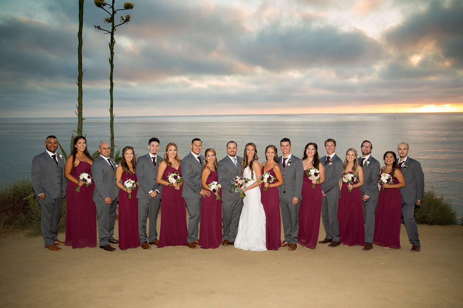 full bridal party photo with red dresses