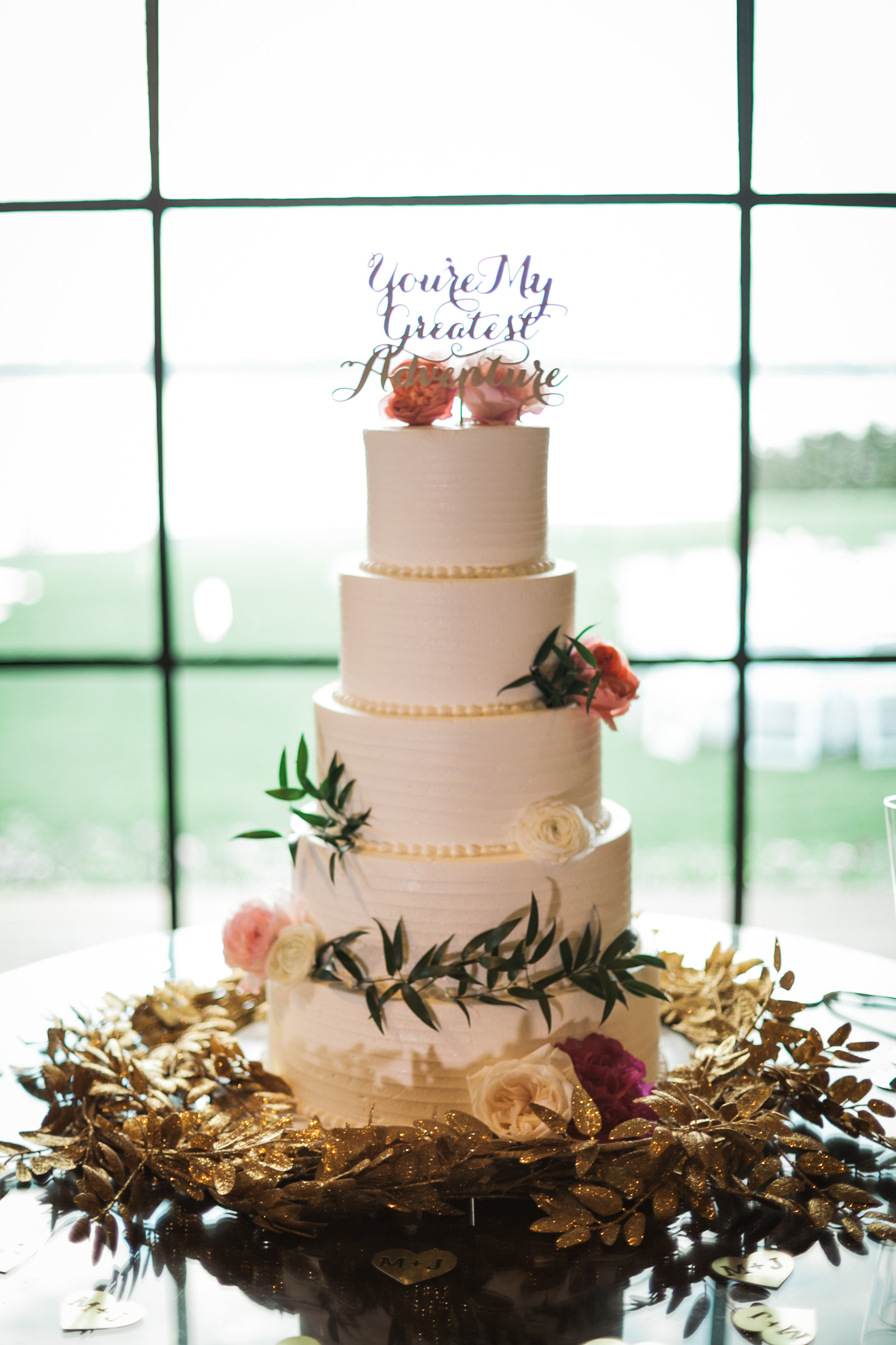 five tier wedding cake from panini bakery for a dallas texas wedding reception