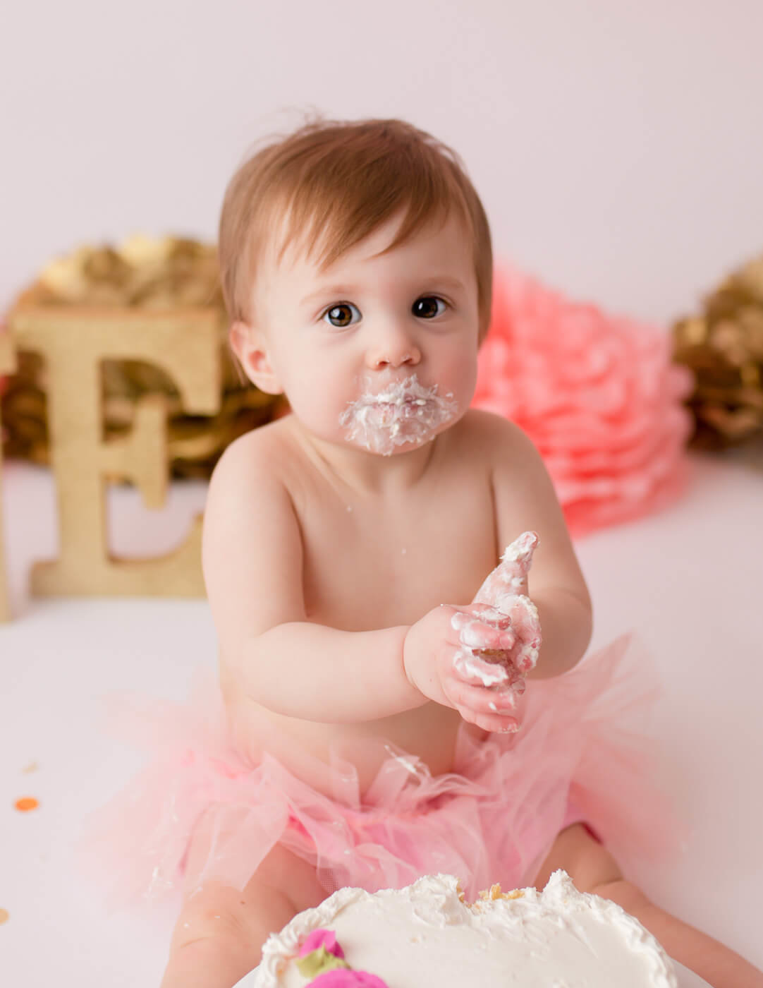 Precious one year old girl cake smash in our in-home studio in Rochester, NY.