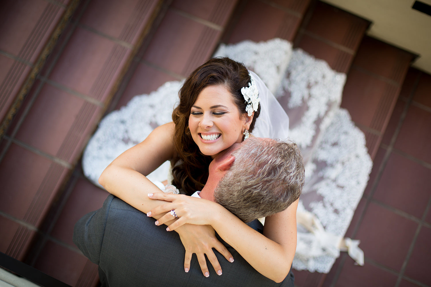 Romantic moment on the stairs with bride and groom