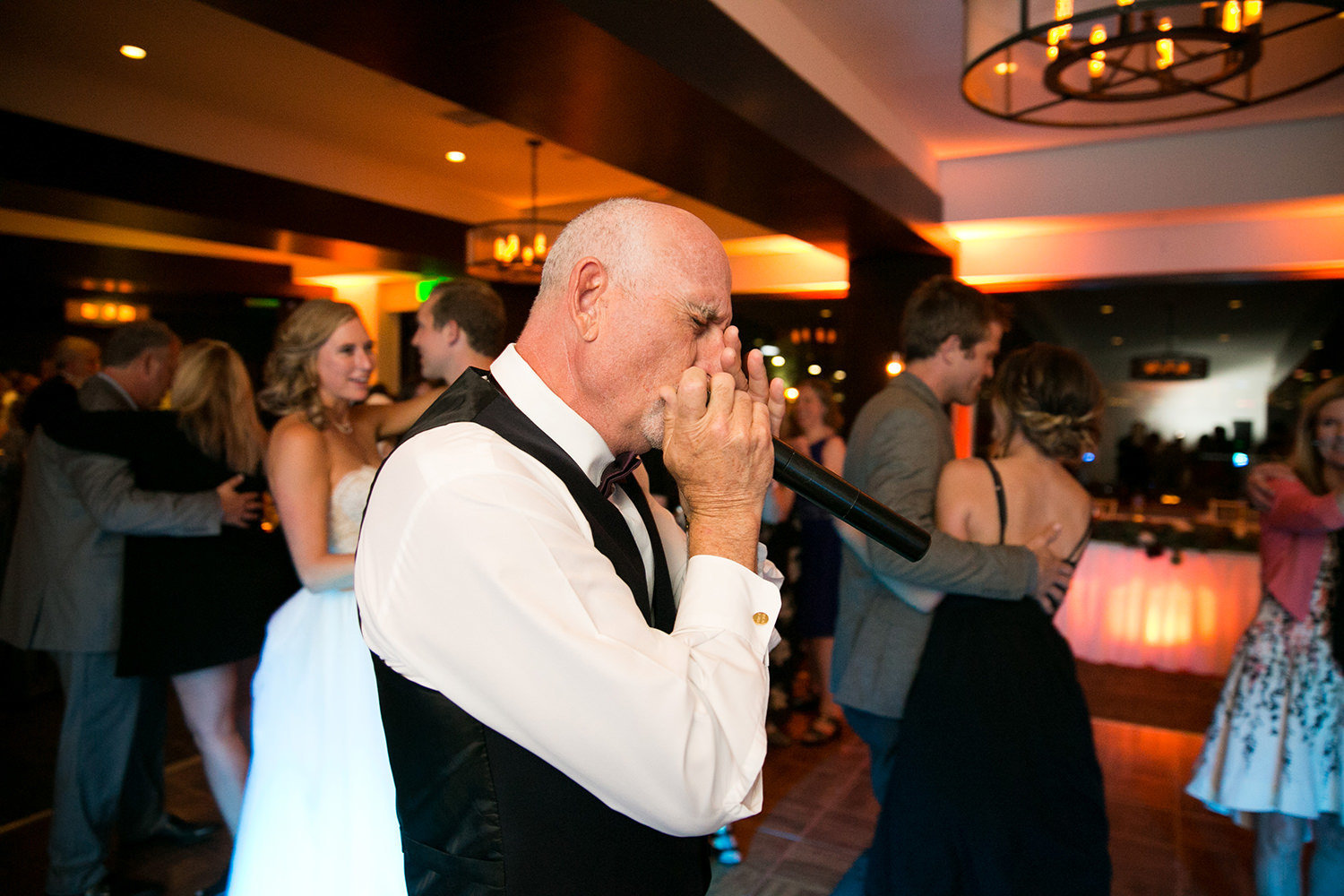 father of the bride singing at reception