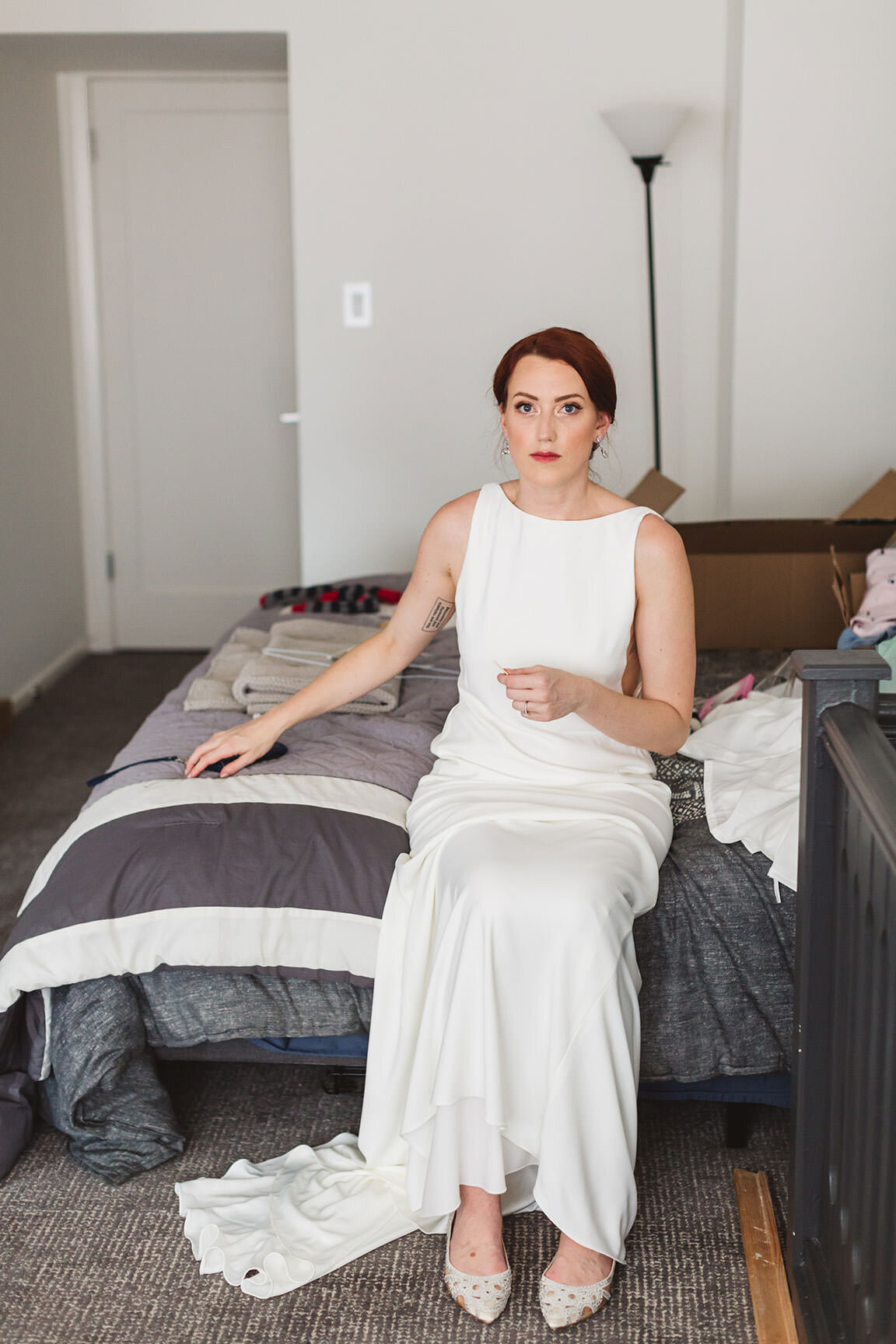 candid stark wedding photography of bride sittin on bed in her san francisco home