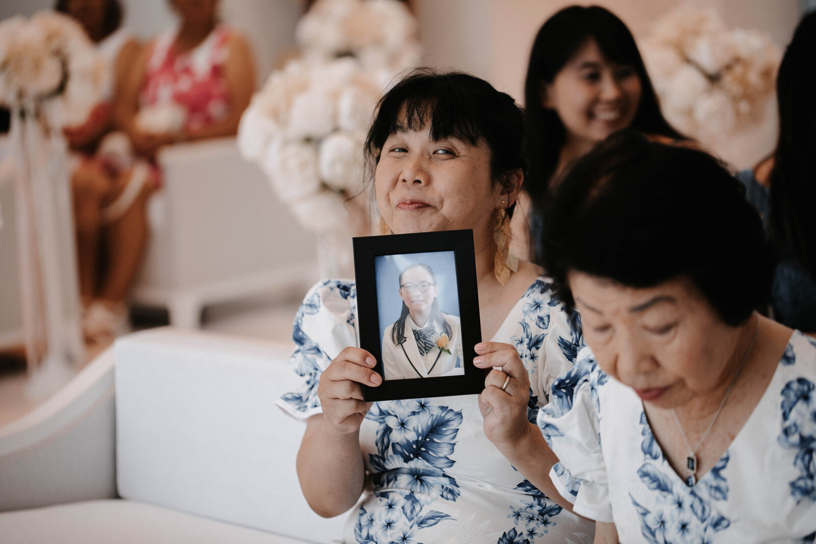 mother-holds-up-picture-for-guest-who-could-not-attend-the-wedding