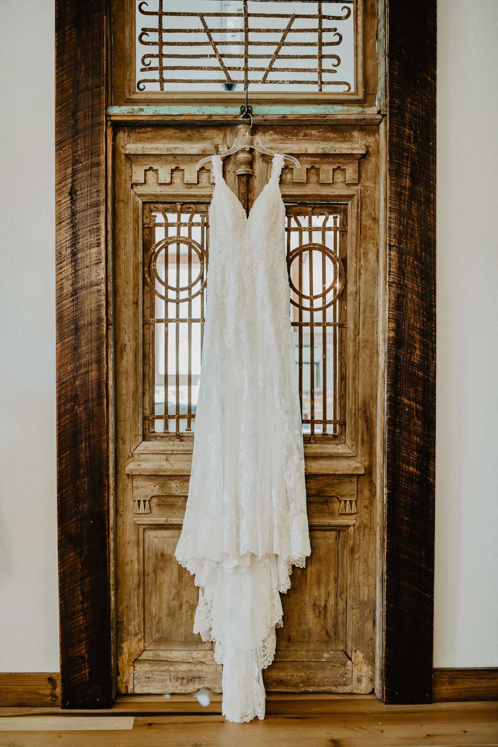 With European details Cason's Cove was a perfect match to hang this brides dress in front of.