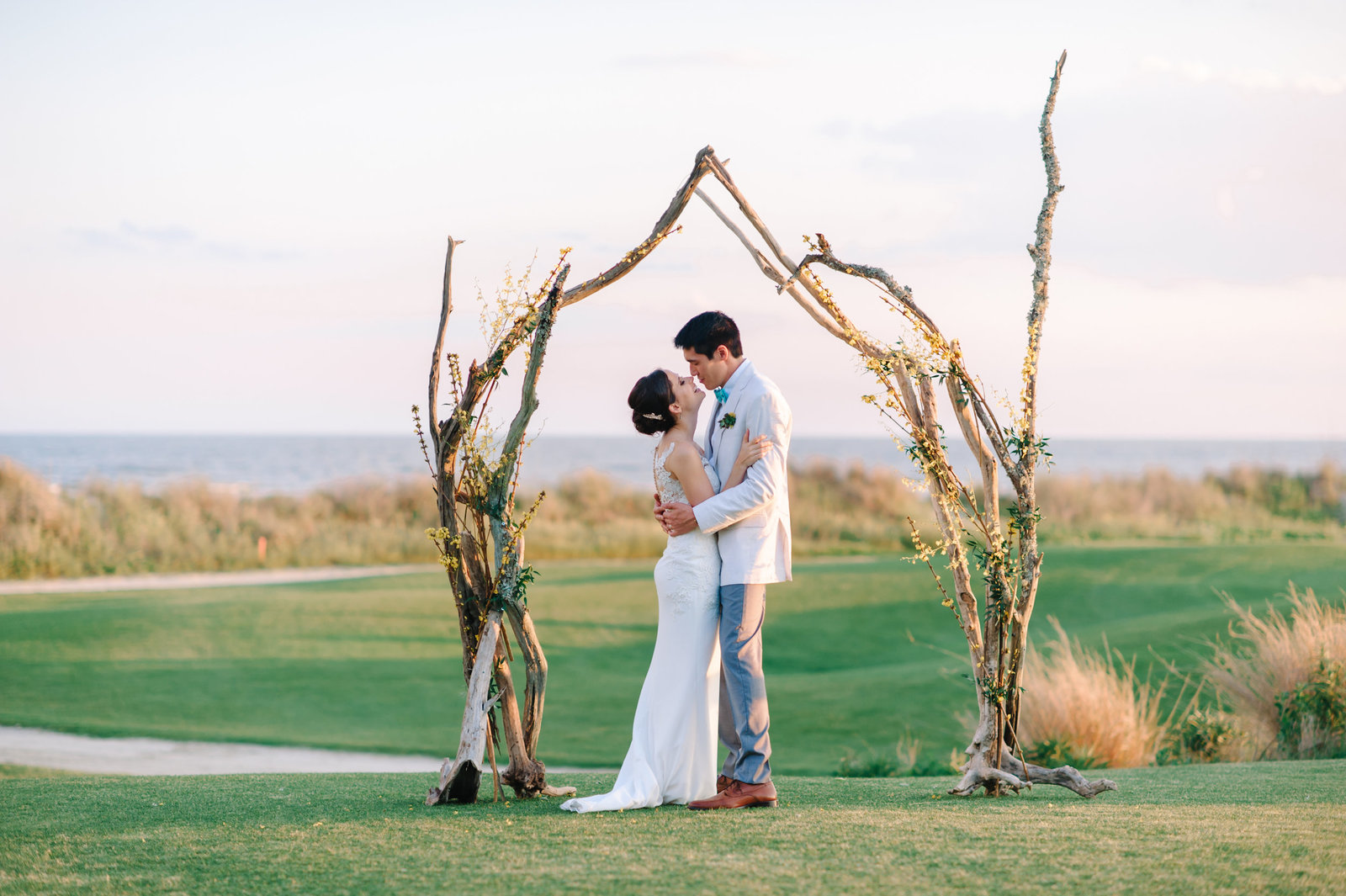 Destination Wedding Photographers in Charleston - ceremony with beach view