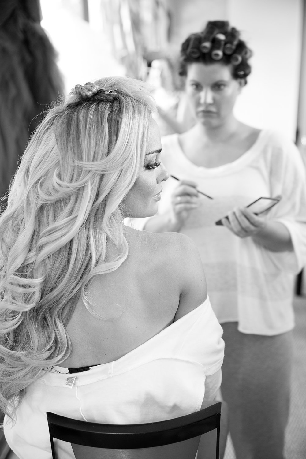 Lovely black and white moment while bride is getting ready