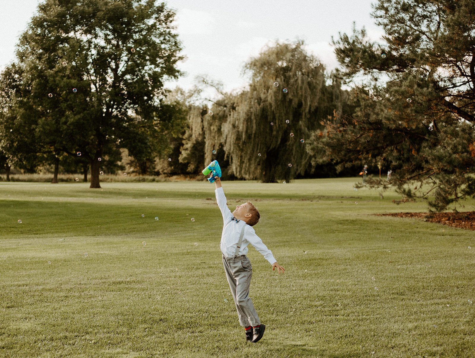 Ring bearer playing outside during a Minneapolis Wedding