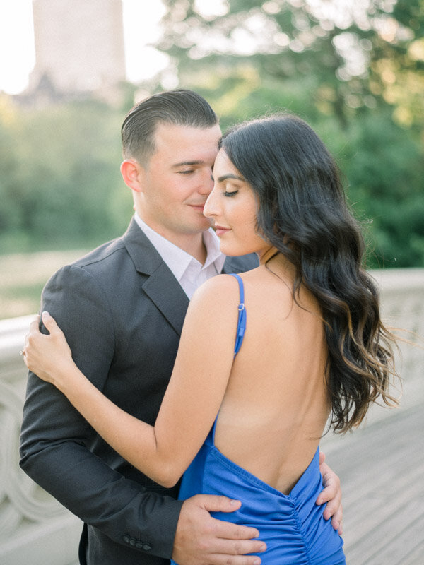 Bride to be wears blue gown for engagement session in NYC
