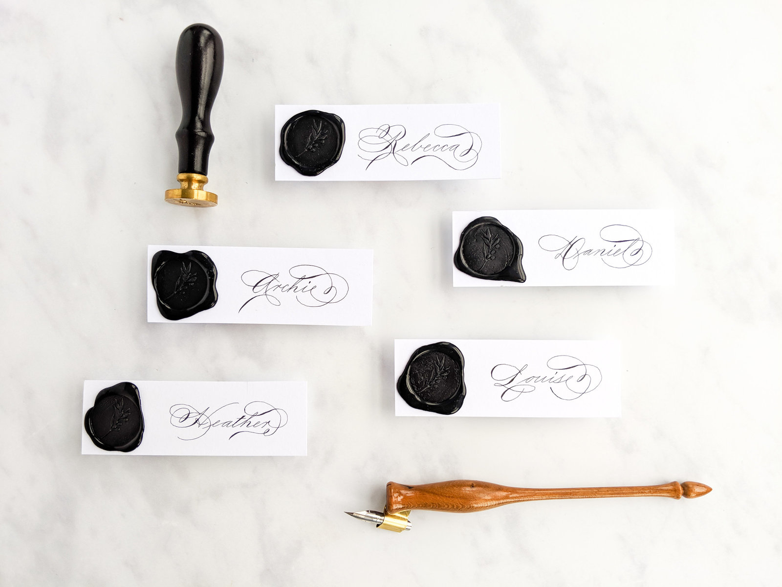 Black wax seal place cards with calligraphy for wedding