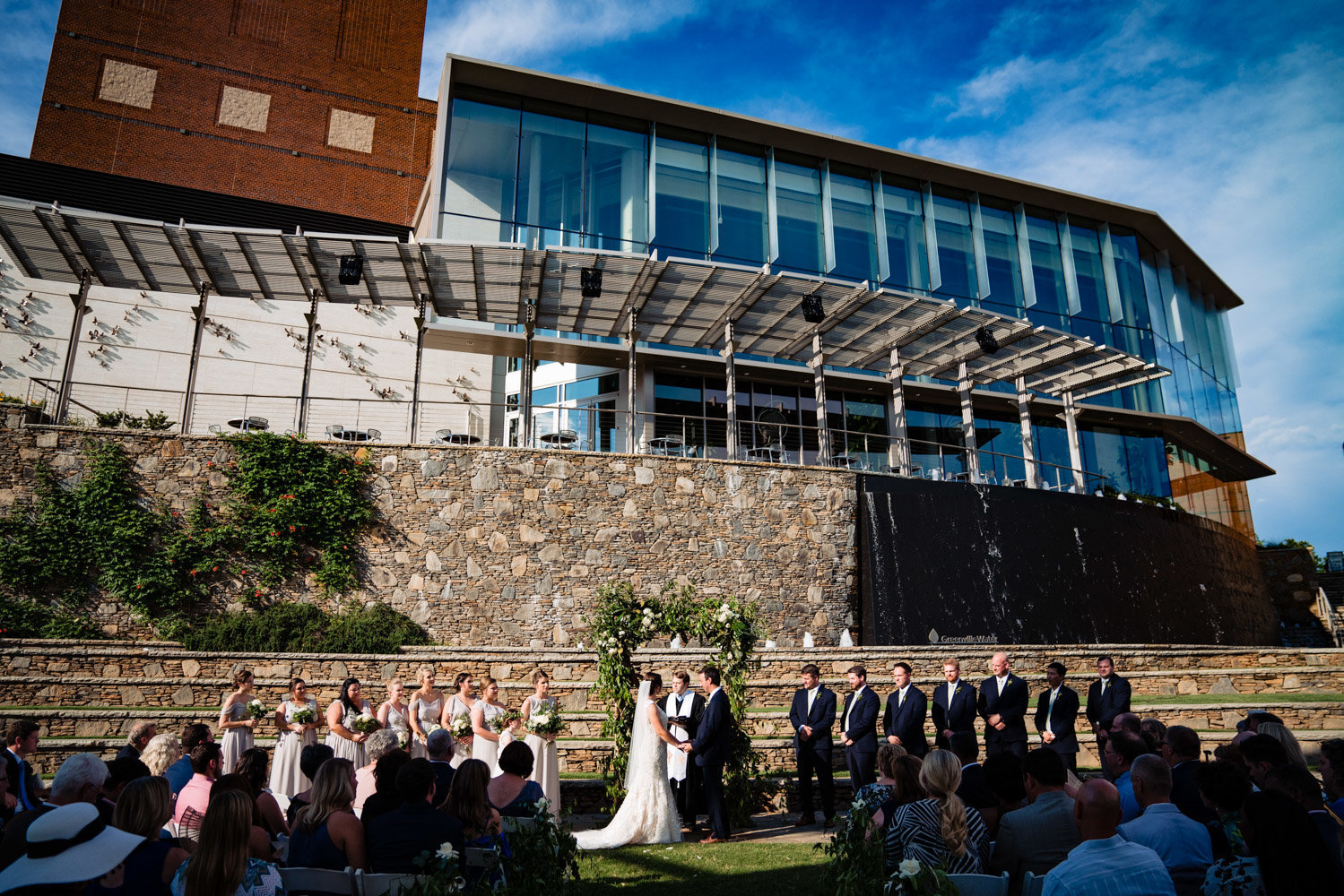 outdoor wedding ceremony near rock wall