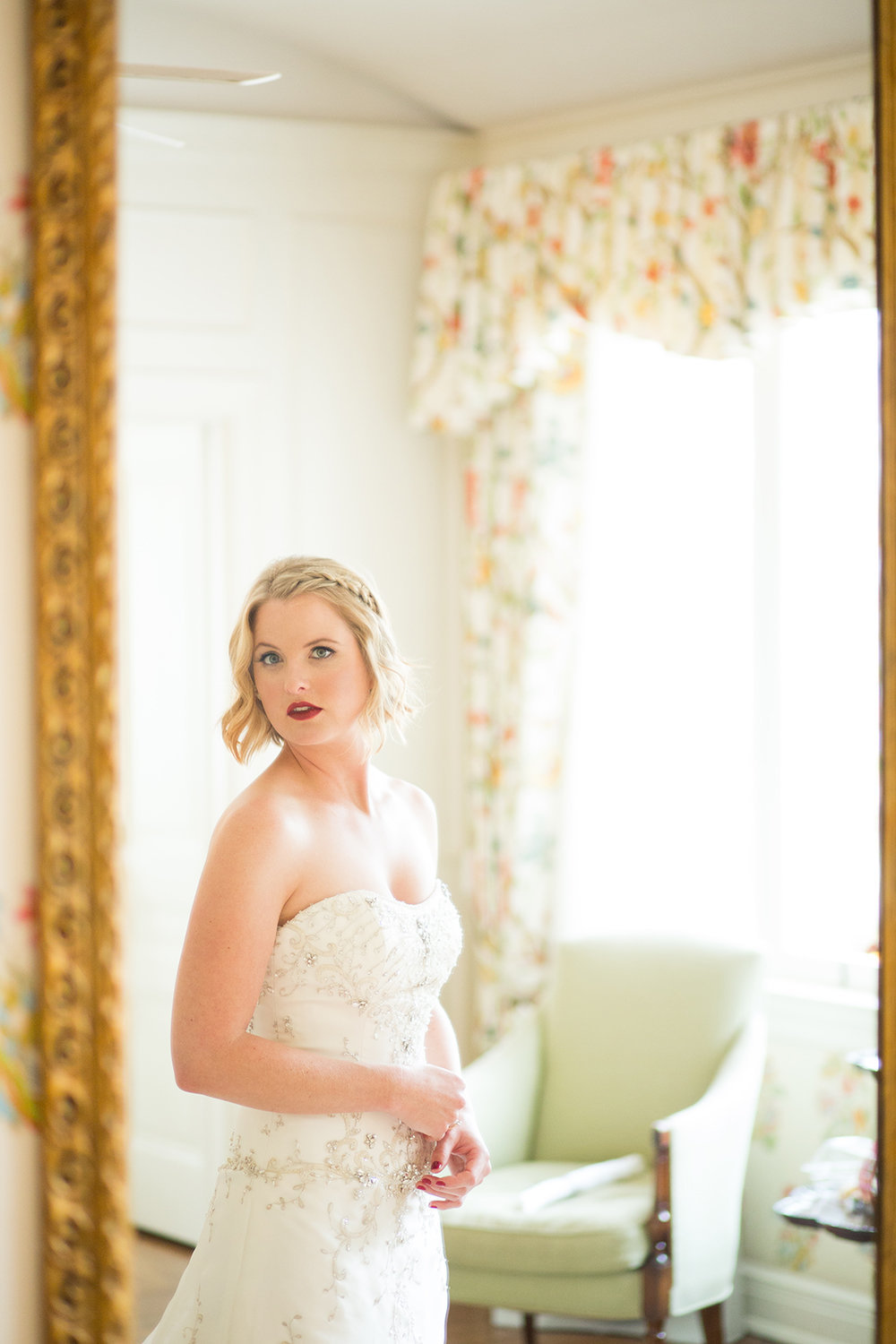 bride looking in the mirror at darlington house