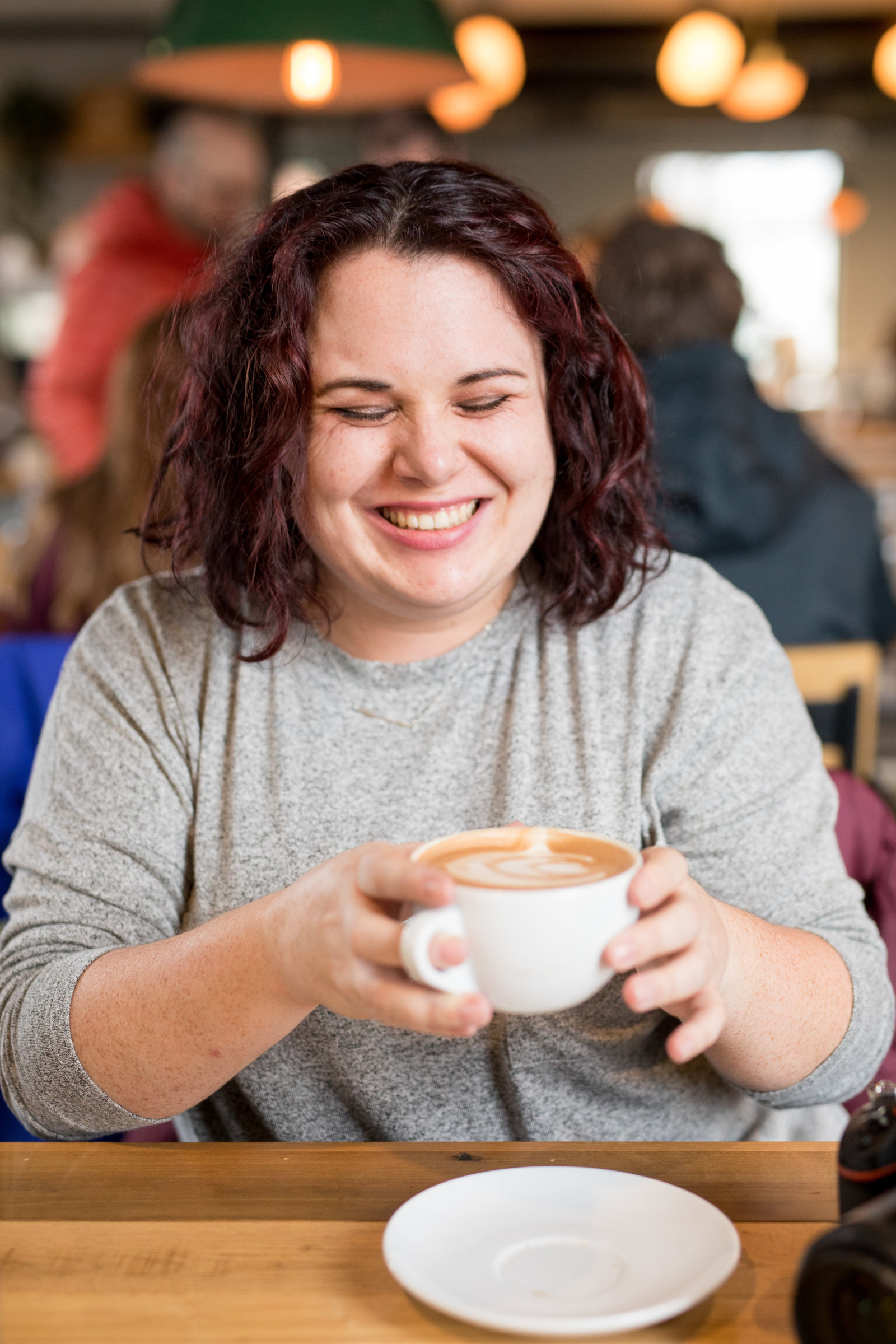 Woman enjoys coffee at Fox in the Snow Cafe